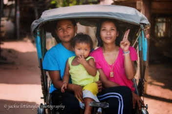 two woman and a child in a rickshaw soft