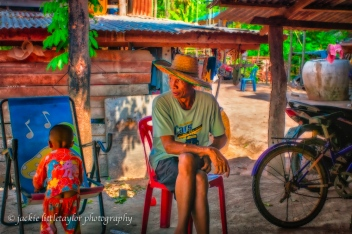 viilage elder with hat Issan Thailand impression color
