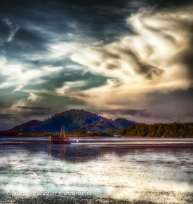 low tide sunset trawler in mud 1
