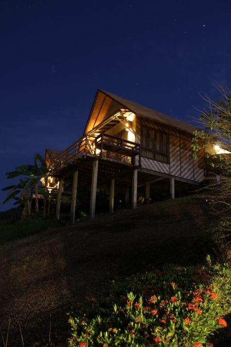 Upper level bungalow at night.