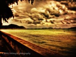Rawai Pier golden sunset heavy dark clouds Impression A