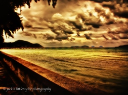 Rawai Pier golden sunset heavy dark clouds Impression A