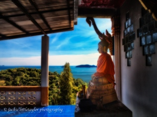 small Buddha overlooking Andaman Sea Wat Siray Thailand