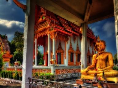 sitting Buddha facing sea Wat Sapum Thammaram dark sky