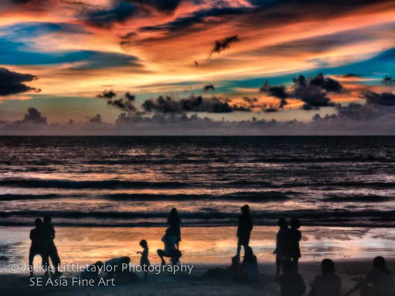sunset Patong Beach clouds people play