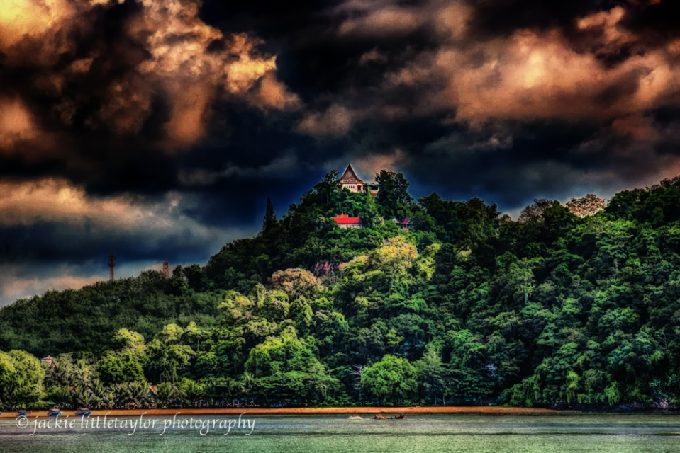 Temple on Green Hill along coast storm clouds sunrise