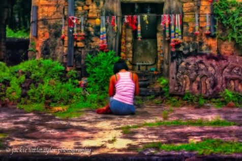 young Thai woman praying Prasat Ban Prasat Issan Village Life i