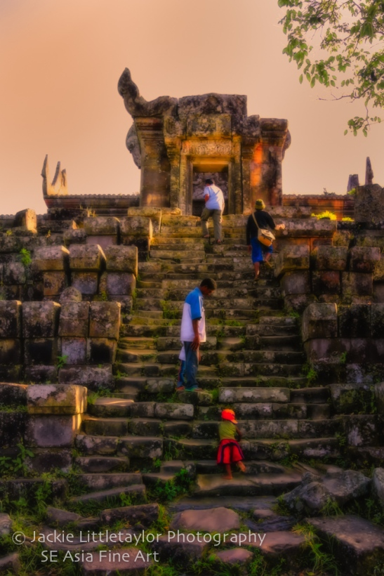 little boy walking up stone stairs preah Vihear impression