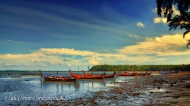 long tail boats on beach sunset 16x9