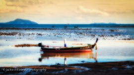 longtail boat low tide reflection in water 16x9 impression soft