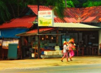 2 flower girls street vendors soft warm glow bright flowers impr