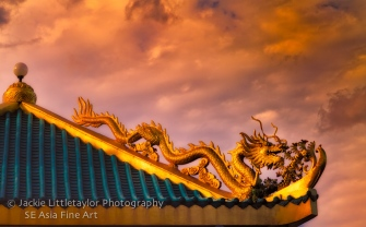 dragon on the roof sunset