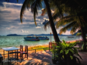 cafe along on Gypsy Beach Siray Island Phuket coconut trees boat