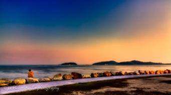 Thinking waterfront sunset alone 16x9 impression