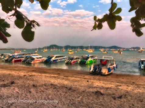speed boats Chalong Beach sunset