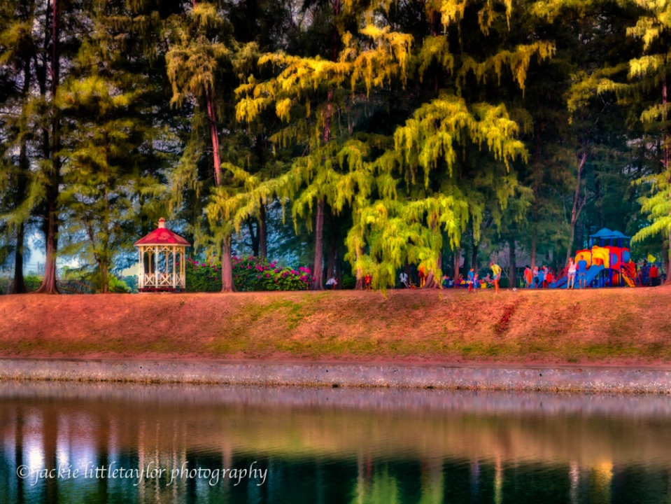 Gazebo on the lake sunset Park families play