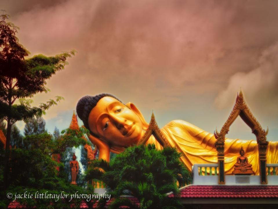 Wat Srisoonthorn reclining buddha dark clouds