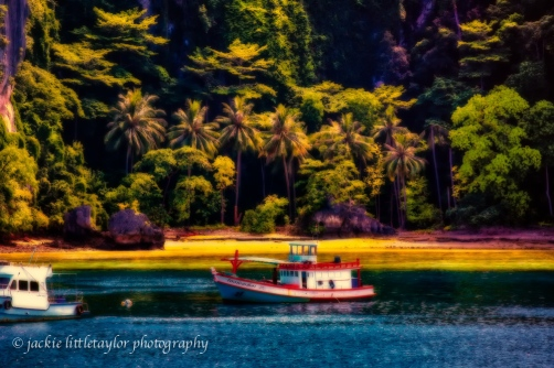 trawler at anchor tropical lagoon Phi Phi Island evening