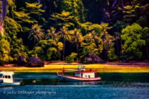 trawler at anchor tropical lagoon Phi Phi Island evening