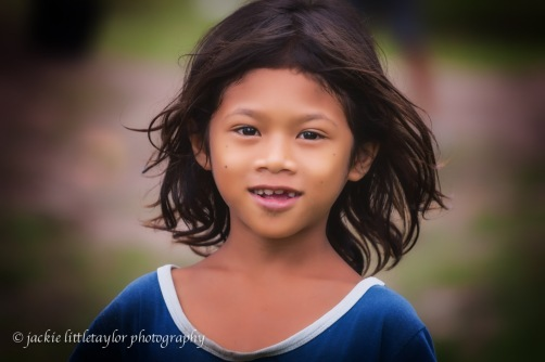 young issan girl hair blowing in wind Village life