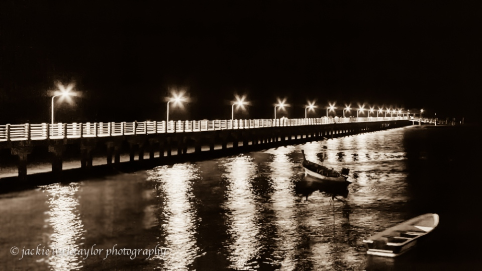 lighted pier at night B/W 16x9