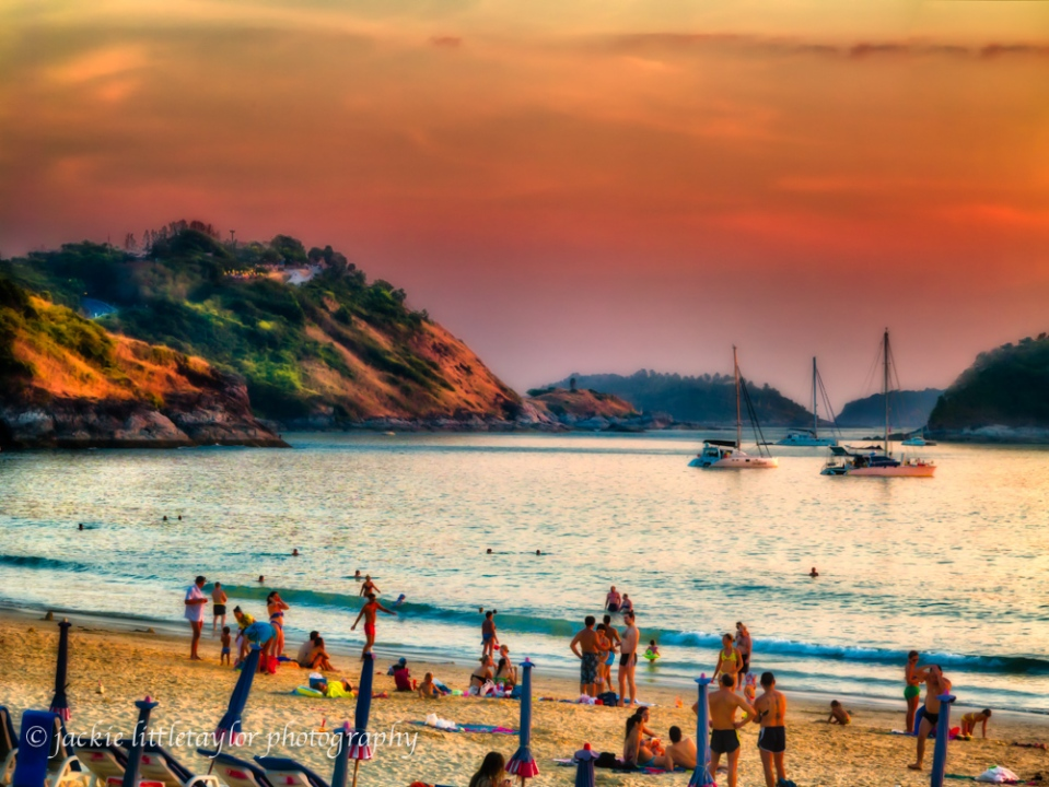 families tourist play Nai Harn Beach Phuket Thailand sunset