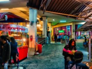 people shopping Bus Stop Chumporn Bangkok/Phuket Thailand