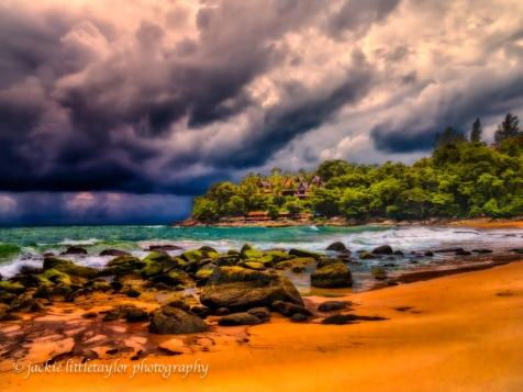 Coastline waves dark clouds Laem Singh Thailand impression