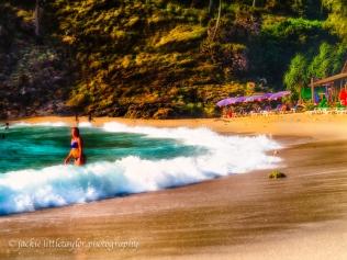 blue bikini in the surf beach sunset