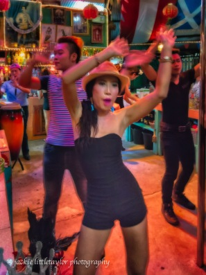 girl in the hat dancing sunshine bar