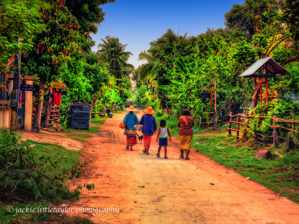 3 woman and a girl walking home  Issan Village life impression