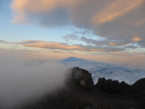 Mountain shadow - sunrise at the summit