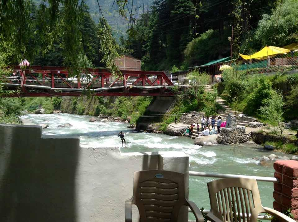 Across the red bridge from New Manali to old manali...river called Manalsu River