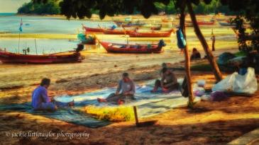 fisherman building their fishing nets low tide beach 16x9 impre