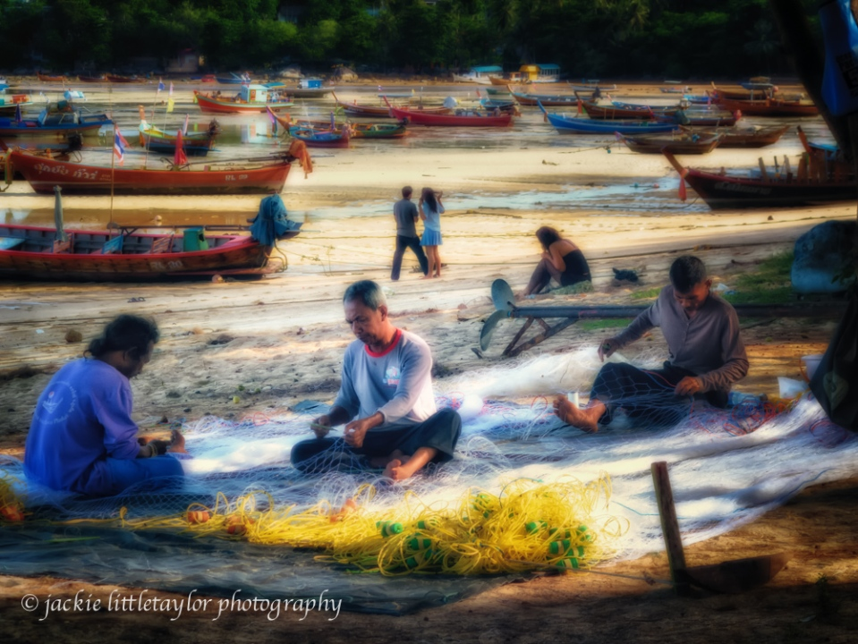 3 men working on fishing nets   fishing village impression soft