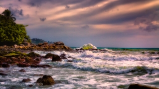 wave crashing dark clouds impression