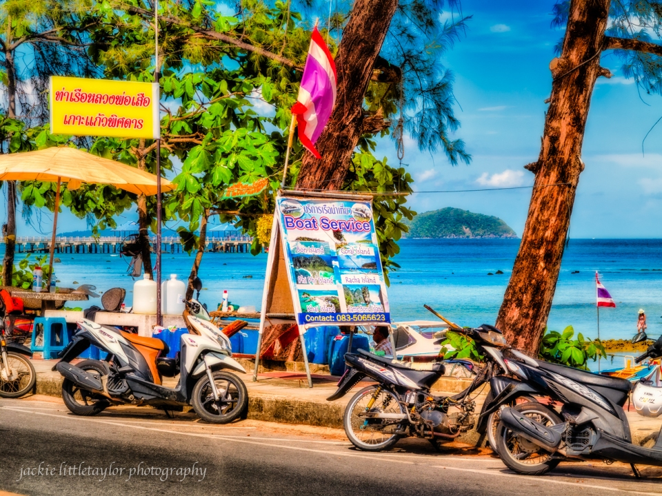 Boat Service signs all along Rawai Beach Road