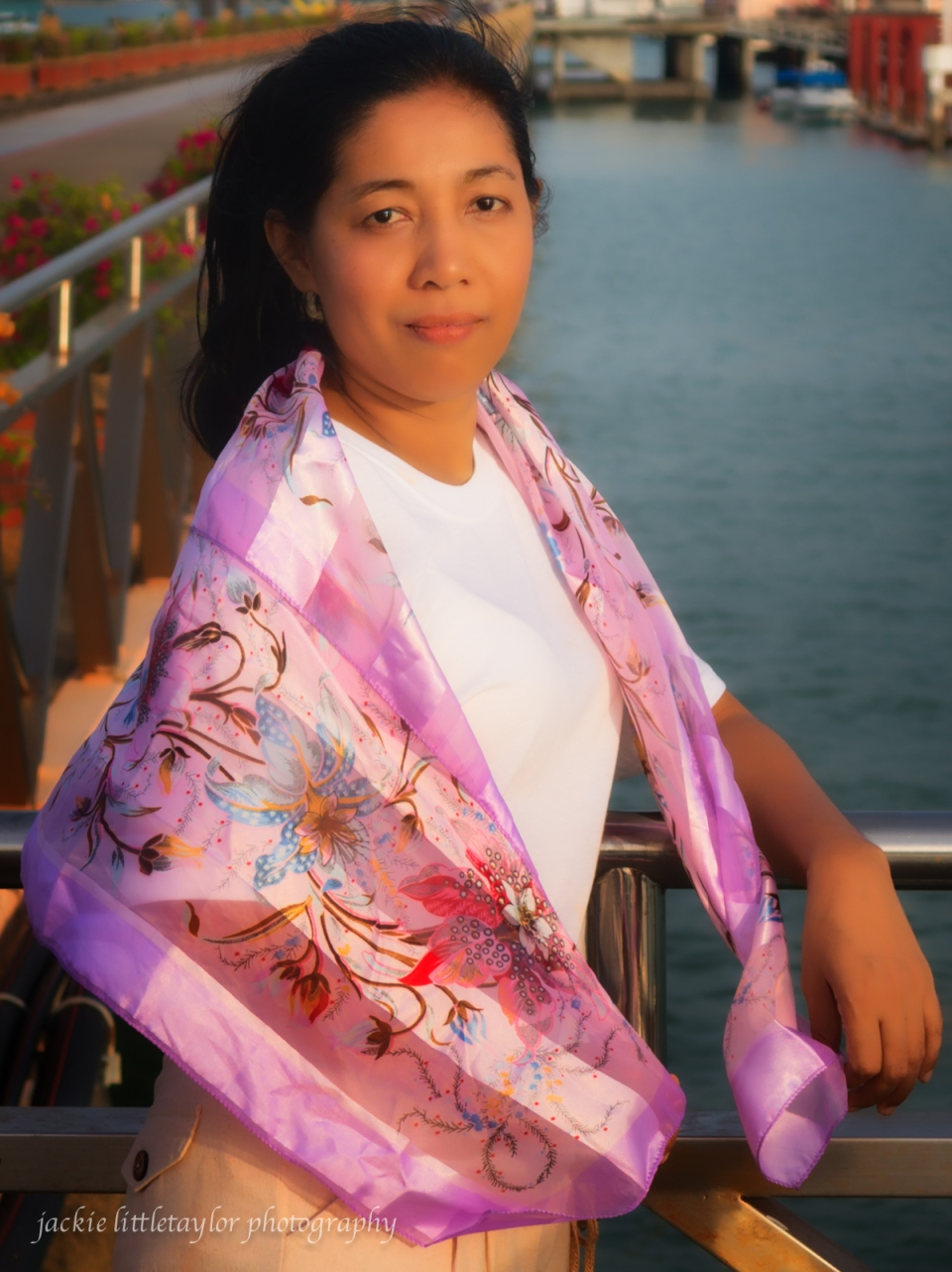 lovely mature Thai woman at sunset and water