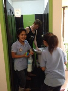 These two giggly girls helping my friend Stuart out with handwashing his clothes in the sink...
