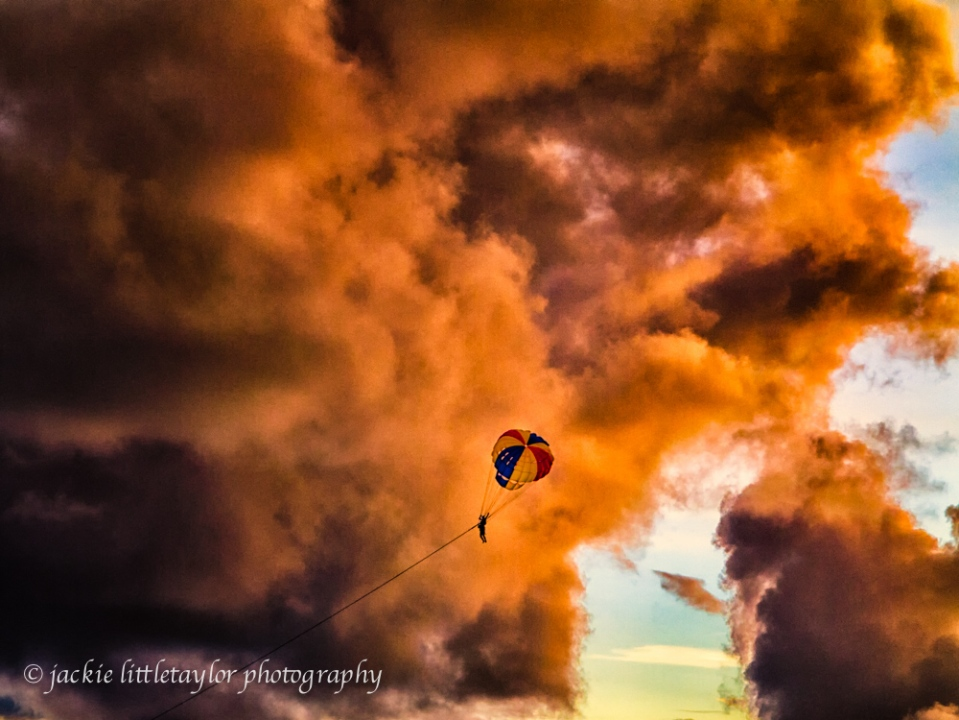 parachute sunset dark clouds